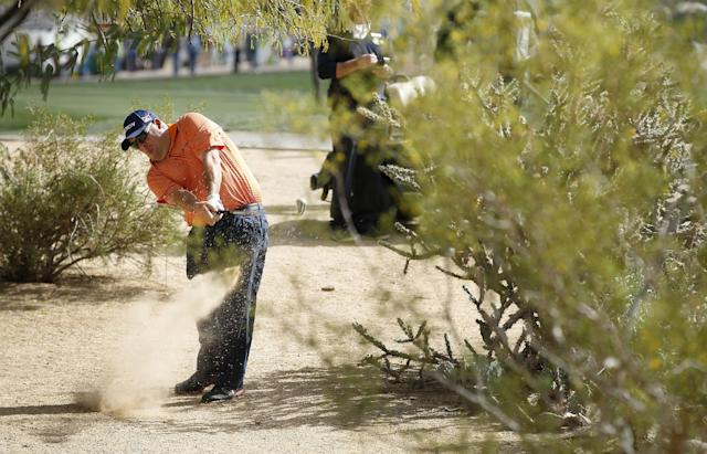 Kevin Stadler hits out of the desert on the 11th hole during the final round of the Phoenix Open golf tournament on Sunday, Feb. 2, 2014, in Scottsdale, Ariz. (AP Photo/Ross D. Franklin)
