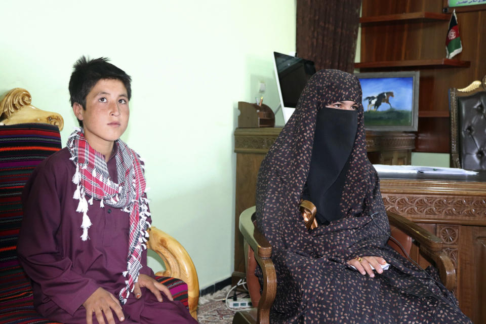 Qamar Gul, 16, right, and her brother Habibullah, 12, pose for photograph in the governor's office in Feroz Koh, the provincial capital of Ghor province, in western Afghanistan, Tuesday, July 21, 2020. The Afghan teenager and her younger brother are being hailed as heroes on social media after reportedly fighting off Taliban militants who killed their parents last week in central Afghanistan. Following the attack and the attention the incident triggered, the children are being brought to the capital, Kabul, to meet Afghan President Ashraf Ghani, possibly later on Wednesday. (AP Photo)