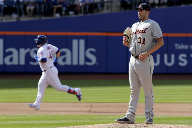 Detroit Tigers starting pitcher Ryan Carpenter, right, stands on the mound as New York Mets' Wilson Ramos runs the bases after hitting a solo home run off him during the second inning of an interleague baseball game, Saturday, May 25, 2019, in New York. (AP Photo/Julio Cortez)