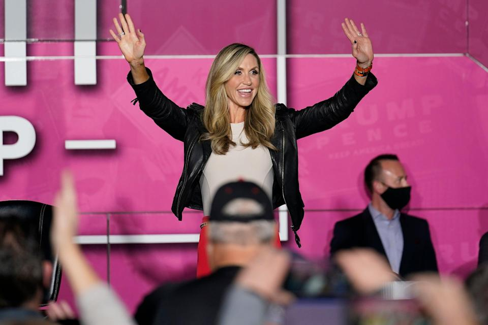 Lara Trump waves as she arrives on a Women for Trump Bus Tour campaign event on 8 October 2020. (AP)