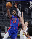 Detroit Pistons guard Josh Jackson (20) makes a layup as Cleveland Cavaliers guard Matthew Dellavedova defends during the second half of an NBA basketball game, Monday, April 19, 2021, in Detroit. (AP Photo/Carlos Osorio)