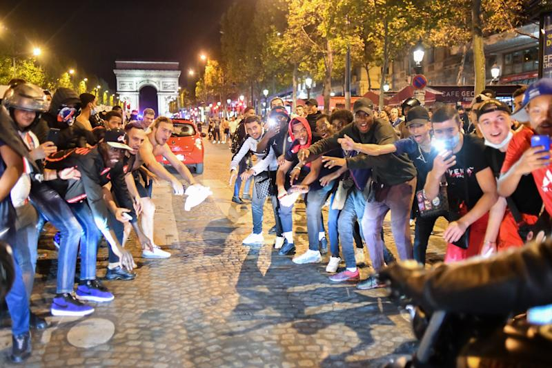 PARIS, FRANCE - AUGUST 19: PSG fans gathered in Champs Elysee to celebrate the winning in the UEFA Champions League semi-finals in Paris, France on August 19, 2020. Police take security measures around the site. France's Paris Saint-Germain has reached the UEFA Champions League final for the first time after beating German side RB Leipzig 3-0 Tuesday. (Photo by Julien Mattia/Anadolu Agency via Getty Images)