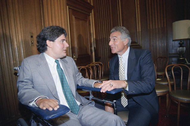 FILE - In this June 28, 1989, file photo, Marc Buoniconti, left, and his father, former Miami Dolphins player Nick Buoniconti, speak after Marc received the American Institute for Public Service Jefferson Award at the Supreme Court in Washington. Pro Football Hall of Fame middle linebacker Nick Buoniconti, an undersized overachiever who helped lead the Miami Dolphins to the NFL's only perfect season, has died at the age of 78. Bruce Bobbins, a spokesman for the Buoniconti family, said he died Tuesday, July 30, 2019, in Bridgehampton, N.Y. (AP Photo/J. Scott Applewhite)