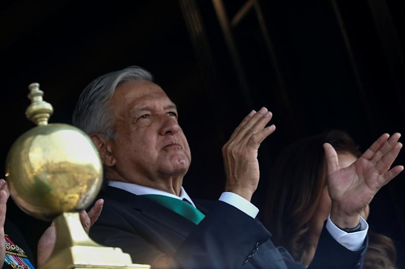Mexico's President Andres Manuel Lopez Obrador applauds as he looks on from a balcony during a military parade in celebration of the 109th anniversary of the Mexican Revolution at Zocalo Square in Mexico City, Mexico November 20, 2019. REUTERS/Edgard Garrido