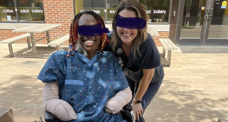 A photo of the woman with a nurse in the hospital courtyard a week after she had both her legs and feet amputated. Source: Twitter/WesElyMD