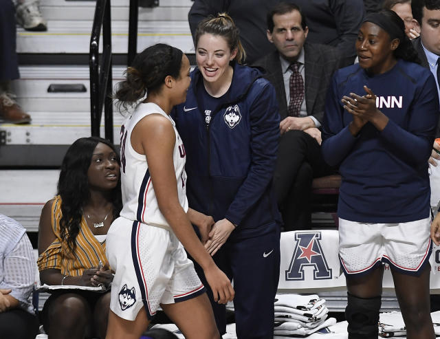 Connecticut's Katie Lou Samuelson, center, greets Napheesa Collier, left, as Collier finishes playing during the second half of an NCAA college basketball game in the American Athletic Conference tournament quarterfinals against East Carolina, Saturday, March 9, 2019, at Mohegan Sun Arena in Uncasville, Conn. At right is Connecticut's Batouly Camara. (AP Photo/Jessica Hill)