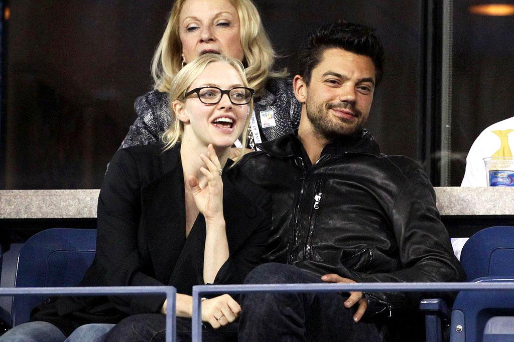 """Mamma Mia!"" co-stars/lovebirds Amanda Seyfried and Dominic Cooper got a little cozy while rooting for their favorite players. Juan Soliz/<a href=""http://www.pacificcoastnews.com/"" target=""new"">PacificCoastNews.com</a> - September 3, 2009"