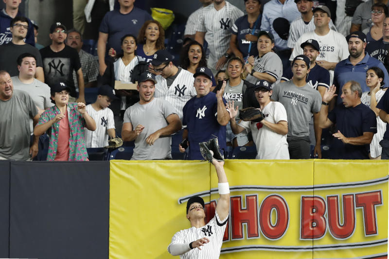 New York Yankees' right fielder Aaron Judge reaches up and catches a fly ball by Tampa Bay Rays' Austin Meadows during the fifth inning of the second game of a baseball doubleheader, Thursday, July 18, 2019, in New York. (AP Photo/Kathy Willens)