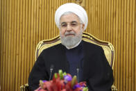 """In this photo released by the official website of the office of the Iranian Presidency, President Hassan Rouhani sits at the Mehrabad airport pavilion before leaving Tehran, Iran, for New York to attend United Nations General Assembly, Monday, Sept. 23, 2019. Rouhani, before traveling to attend the U.N. meetings, said Monday that Iran will invite """"all littoral states of the Persian Gulf"""" to join its coalition """"to guarantee the region's security."""" (Iranian Presidency Office via AP)"""