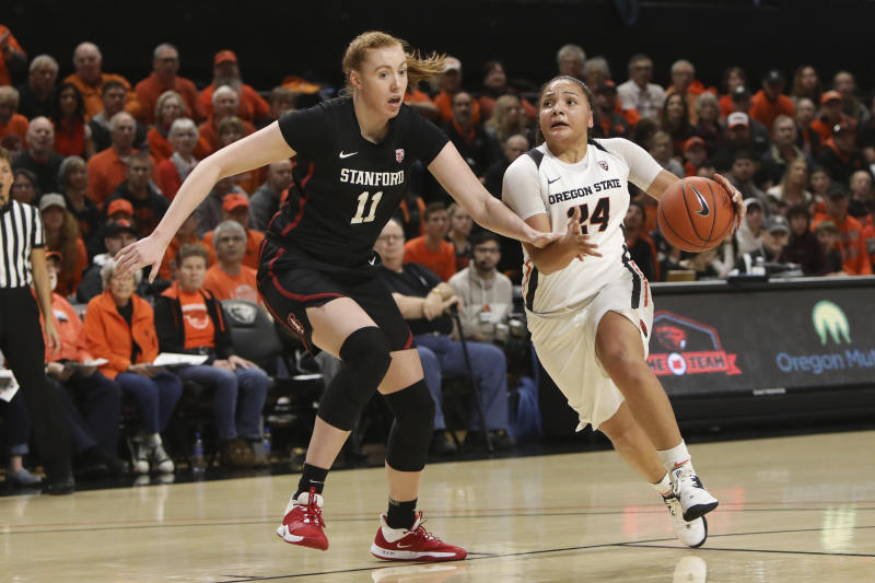Stanford's Ashten Prechtel (11) keeps up with Oregon State's Destiny Slocum (24) as she sprints upcourt during the first half of an NCAA college basketball game in Corvallis, Ore., Sunday, Jan. 19, 2020. (AP Photo/Amanda Loman)