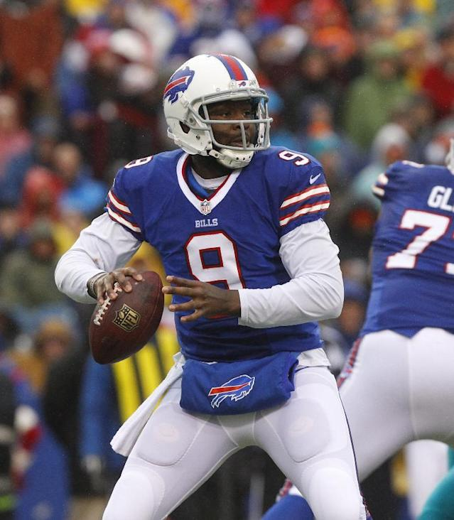 Buffalo Bills quarterback Thad Lewis (9) passes against the Miami Dolphins during the first half of an NFL football game on Sunday, Dec. 22, 2013, in Orchard Park, N.Y. (AP Photo/Bill Wippert)