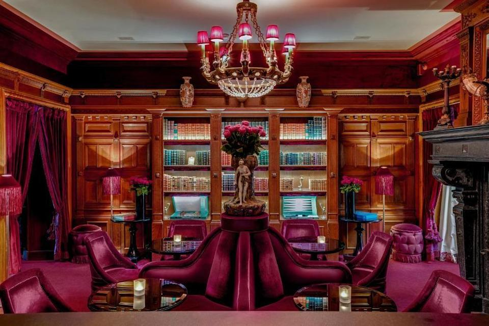 """<p>The illustrious <a href=""""https://www.booking.com/hotel/fr/maison-souquet.en-gb.html?aid=1922306&label=paris-hotels"""" rel=""""nofollow noopener"""" target=""""_blank"""" data-ylk=""""slk:Maison Souquet"""" class=""""link rapid-noclick-resp"""">Maison Souquet</a> was once a Belle Époque pleasure house - and it shows. With red velvet curtains, sculpted wood-panel bookshelves and glinting chandeliers, it's a real treat playing a spot of backgammon among elaborate gilded wallpapers and renaissance paintings. As one of the best hotels in Paris, Maison Souquet sits at the foot of Montmartre near the iconic Moulin Rouge. </p><p>This old-timely location harks back to the cabarets of the literary boom era - and you'll feel this history throughout the hotel. Whether you're resting in one of the individually designed silk-lined rooms, savouring craft cocktails in the dark wood bar or pampering in the darkly indulgent indigo-walled spa, five-star luxury awaits around every exotic corner.</p><p><a class=""""link rapid-noclick-resp"""" href=""""https://www.booking.com/hotel/fr/maison-souquet.en-gb.html?aid=1922306&label=paris-hotels"""" rel=""""nofollow noopener"""" target=""""_blank"""" data-ylk=""""slk:CHECK AVAILABILITY"""">CHECK AVAILABILITY</a></p>"""