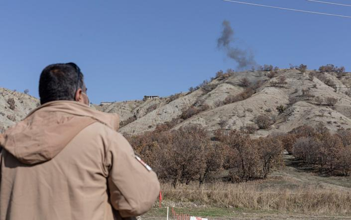 A de-miner working for Mine Advisory Group watches a controlled detonation of landmines planted during the Iran-Iraq war - Sam Tarling/Sam Tarling
