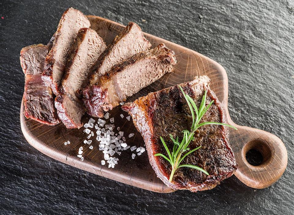 well done cooked steak on cutting board
