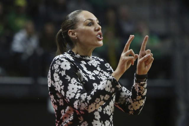 Arizona coach Asia Barnes calls to her team during the first quarter of an NCAA college basketball game against Oregon in Eugene, Ore., Friday, Feb. 7, 2020. (AP Photo/Chris Pietsch)