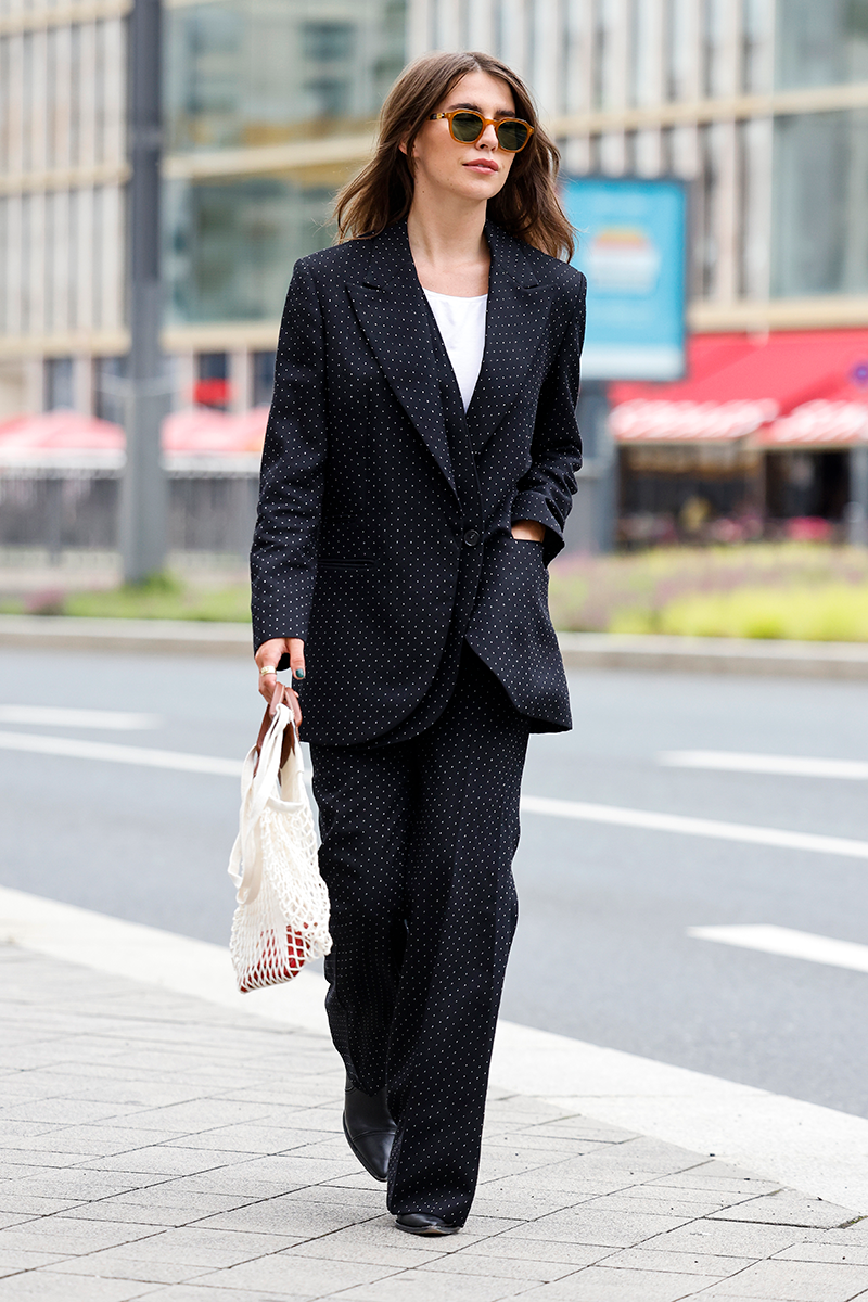 <p>This classic two-piece trouser suit is a timeless look, brought into the warmer months with the string shopper bag doubling as a handbag.</p>
