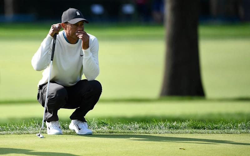 Tiger Woods looks over his putt on the 17th green during the second round of the U.S. Open - USA TODAY SPORTS