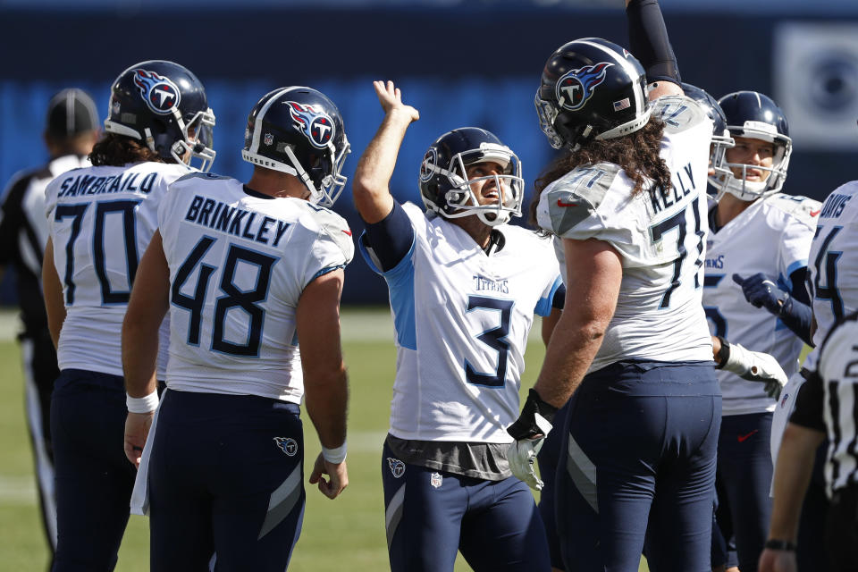 Tennessee Titans kicker Stephen Gostkowski (3) celebrates with Dennis Kelly (71) after kicking a 49-yard field goal against the Jacksonville Jaguars in the second half of an NFL football game Sunday, Sept. 20, 2020, in Nashville, Tenn. (AP Photo/Wade Payne)