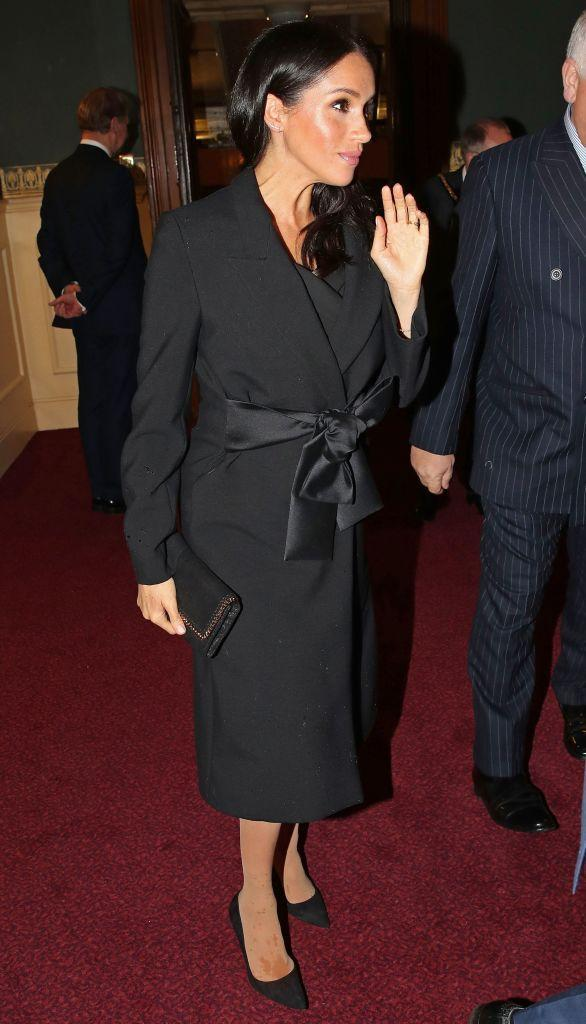 <p>For the Royal British Legion Festival of Remembrance at the Royal Albert Hall in London on November 10, Meghan recycled a Stella McCartney coat she first wore in Wales. The Duchess accessorised the ensemble with Manolo Blahnik pumps and earrings by Zofia Day. <em>[Photo: Getty]</em> </p>