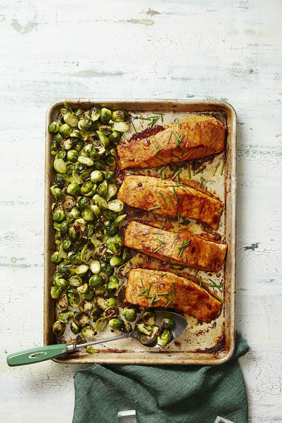"<p>Roast the Brussels sprouts and salmon on the same baking sheet, and you'll have less dishes to clean later.</p><p><em><a href=""https://www.goodhousekeeping.com/food-recipes/a37311/bbq-salmon-brussels-bake-recipe/"" rel=""nofollow noopener"" target=""_blank"" data-ylk=""slk:Get the recipe for &quot;BBQ&quot; Salmon and Brussels Bake »"" class=""link rapid-noclick-resp"">Get the recipe for ""BBQ"" Salmon and Brussels Bake »</a></em> </p><p><strong>RELATED:</strong> <a href=""https://www.goodhousekeeping.com/food-recipes/healthy/g817/healthy-salmon-dinners/"" rel=""nofollow noopener"" target=""_blank"" data-ylk=""slk:16 Salmon Dinners That Are Super Healthy"" class=""link rapid-noclick-resp"">16 Salmon Dinners That Are Super Healthy</a></p>"