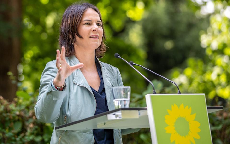 Mandatory Credit: Photo by ANDREAS GORA/POOL/EPA-EFE/Shutterstock (12245436i) Annalena Baerbock, chairwoman and candidate for chancellor of The Greens (Gruene) political party, at the presentation of the immediate climate program, in Biesenthal am Hellsee, Germany, 03 August 2021. Germany: Presentation of the immediate climate program of the Green Party, Biesenthal Am Hellsee - 03 Aug 2021 - ANDREAS GORA/POOL/EPA-EFE/Shutterstock/Shutterstock