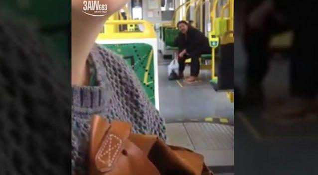 A shoeless man has been filmed yelling at a woman on a Melbourne tram for reading a book. Photo: Youtube