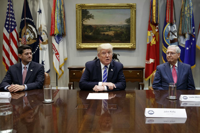 House Speaker Paul Ryan, R-Wis., left, and Senate Majority Leader Mitch McConnell, R-Ky., right, listen as President Trump speaks during a meeting with congressional leaders and administration officials on tax reform at the White House Sept. 5. (Photo: Evan Vucci/AP)