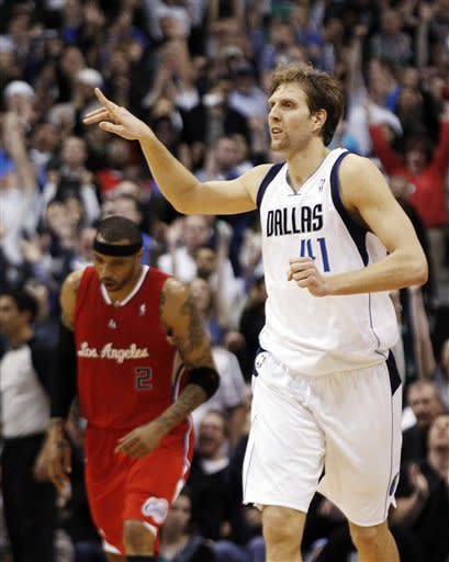 Dallas Mavericks power forward Dirk Nowitzki (41), of Germany, reacts after hitting a 3-pointer against Los Angeles Clippers power forward Kenyon Martin (2) during the fourth quarter of an NBA basketball game in Dallas, Monday, Feb. 13, 2012. The Mavericks won 96-92. (AP Photo/LM Otero)