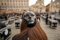 Entertainment workers gather in Piazza del Popolo Square to protest against the Italian government's economic policies to combat the spread of COVID-19 and to demand to reopen their business, in Rome, Saturday, April 17, 2021. (AP Photo/Andrew Medichini)