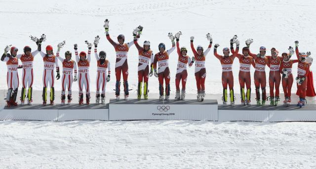 Alpine Skiing - Pyeongchang 2018 Winter Olympics - Team Event - Yongpyong Alpine Centre - Pyeongchang, South Korea - February 24, 2018 - Gold medallist Switzerland's team, silver medallist Austria's team and bronze medallist Norway's team celebrate on the podium during the victory ceremony. REUTERS/Mike Segar