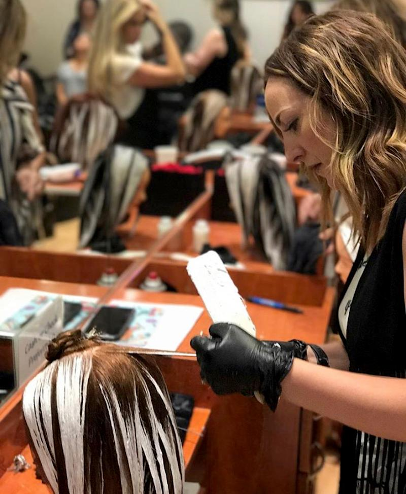 Image: Leslie Leach practices coloring techniques at a Gilbert, Ariz., salon in 2019. Leach closed down her own salon in Chandler this month because of her concerns about the coronavirus. (Pam Leach)