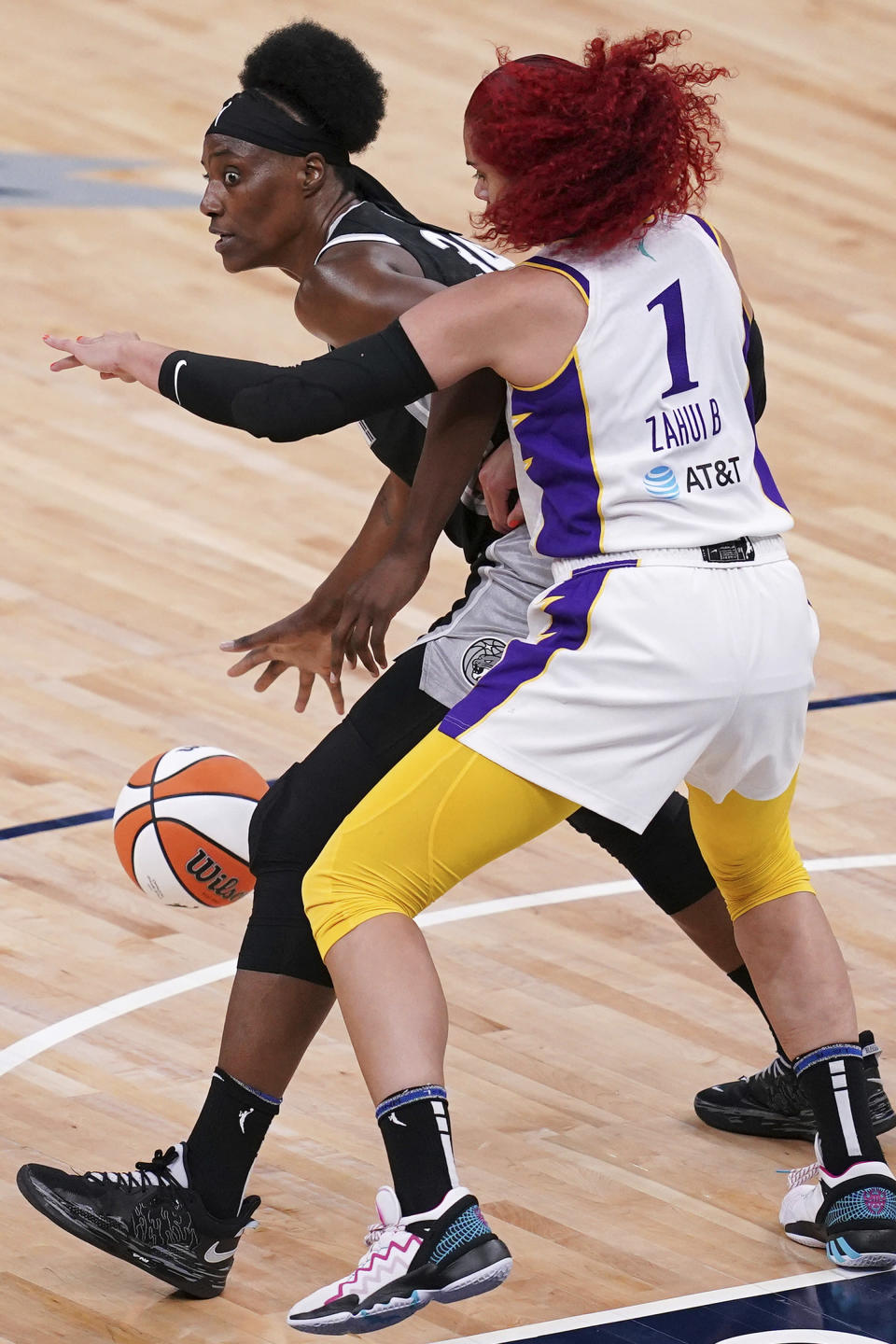 Minnesota Lynx center Sylvia Fowles (34) looks for an open teammate to pass to as Los Angeles Sparks center Amanda Zahui B (1) defends during the second quarterof a WNBA basketball game Saturday, June 12, 2021, in Minneapolis. (Anthony Souffle/Star Tribune via AP)