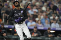 Colorado Rockies' Raimel Tapia reacts after striking out against San Francisco Giants starting pitcher Anthony DeSclafani in the third inning of a baseball game Saturday, Sept. 25, 2021, in Denver. (AP Photo/David Zalubowski)