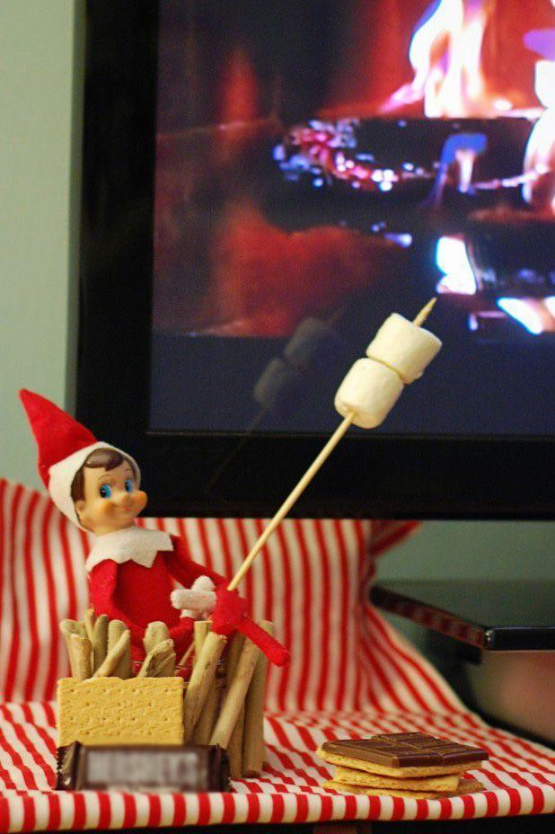 """<p>Turn on the Yule log channel, give your Elf a few marshmallows, and get ready for a delicious, cozy evening with the kids. (Be warned: They're going to ask for some s'mores of their own.)</p><p><strong>Get the tutorial at <a href=""""http://asmallsnippet.com/2013/11/45-elf-on-the-shelf-ideas-from-the-same-elf.html"""" rel=""""nofollow noopener"""" target=""""_blank"""" data-ylk=""""slk:A Small Snippet"""" class=""""link rapid-noclick-resp"""">A Small Snippet</a>.</strong> </p>"""