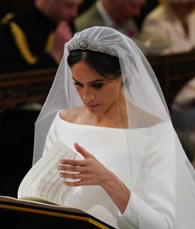 Meghan Markle at the High Altar during her wedding to Britain's Prince Harry, Duke of Sussex in St George's Chapel, Windsor Castle, in Windsor, on May 19, 2018.