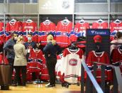 Montreal Canadiens hockey fans purchase jerseys at the Bell Centre during the second away game of the Stanley Cup Finals