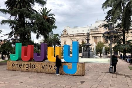 A woman stands in a plaza in front of the provincial government's headquarters in San Salvador de Jujuy