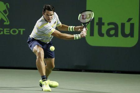 Mar 28, 2018; Key Biscayne, FL, USA; Milos Raonic of Canada hits a backhand against Juan Martin del Potro of Argentina (not pictured) on day nine at the Miami Open at Tennis Center at Crandon Park. Mandatory Credit: Geoff Burke-USA TODAY Sports
