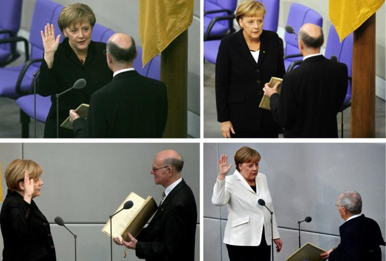 German Chancellor Angela Merkel is formally appointed by President Frank-Walter Steinmeier, a ceremony that marked the end of a painful stretch of post-election paralysis