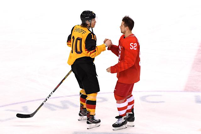 <p>Christian Ehrhoff #10 of Germany and Sergei Shirokov #52 of Olympic Athlete from Russia shake hands after the Men's Gold Medal Game on day sixteen of the PyeongChang 2018 Winter Olympic Games at Gangneung Hockey Centre on February 25, 2018 in Gangneung, South Korea. Olympic Athletes from Russia defeated Germany 4-3 in overtime. (Photo by Harry How/Getty Images) </p>