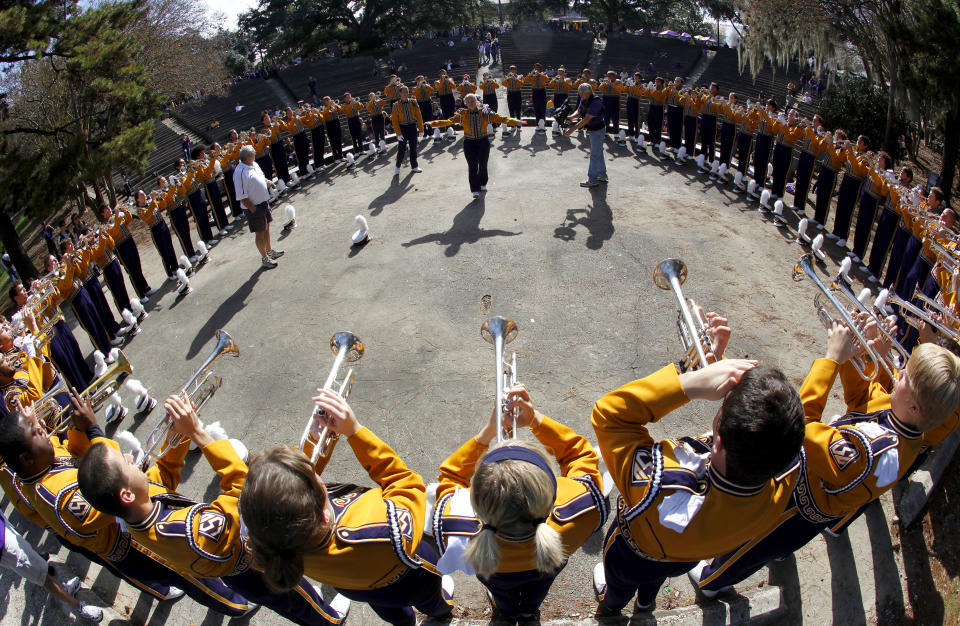 Members of the Louisiana State University Marching Band warm up before their game against the University of Arkansas during their NCAA football game in Baton Rouge, Louisiana November 25, 2011. REUTERS/Sean Gardner (UNITED STATES - Tags: SPORT FOOTBALL)