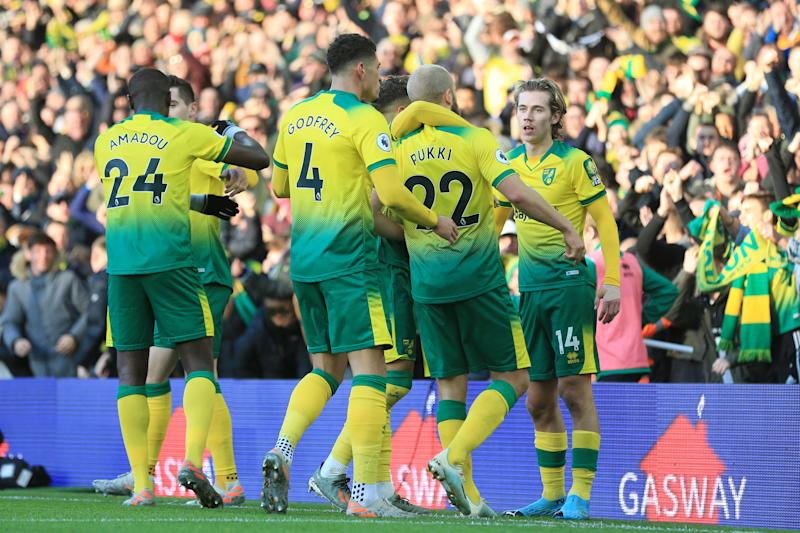 Teemu Pukki of Norwich City celebrates with team mates after scoring his sides first goal. (Credit: Getty Images)