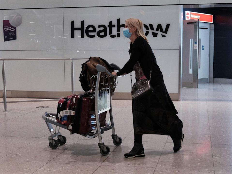 A passenger at Heathrow (PA Wire)