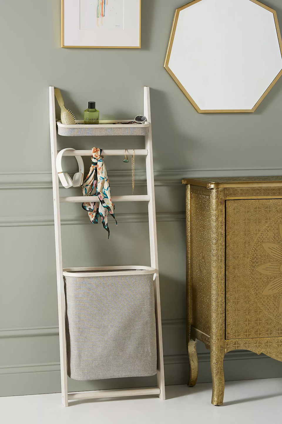 "<h3><a href=""https://www.pbteen.com/products/wall-leaning-storage-rack-with-hamper/"" rel=""nofollow noopener"" target=""_blank"" data-ylk=""slk:Lotus Leaning Storage Rack"" class=""link rapid-noclick-resp"">Lotus Leaning Storage Rack</a></h3> <br><strong>When your bathroom isn't built for storage: </strong>Take advantage of an empty wall with this incredibly functional and space-efficient leaning tower with a built-in laundry hamper, towel rack, a shelf.<br><br><strong>Anthropologie</strong> Lotus Leaning Storage Rack, $, available at <a href=""https://go.skimresources.com/?id=30283X879131&url=https%3A%2F%2Fwww.anthropologie.com%2Fshop%2Flotus-leaning-storage-rack"" rel=""nofollow noopener"" target=""_blank"" data-ylk=""slk:Anthropologie"" class=""link rapid-noclick-resp"">Anthropologie</a>"