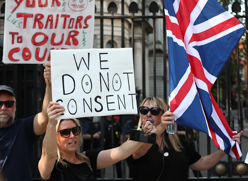 People mount small protest outside Downing Street as rule of six comes into effectPA