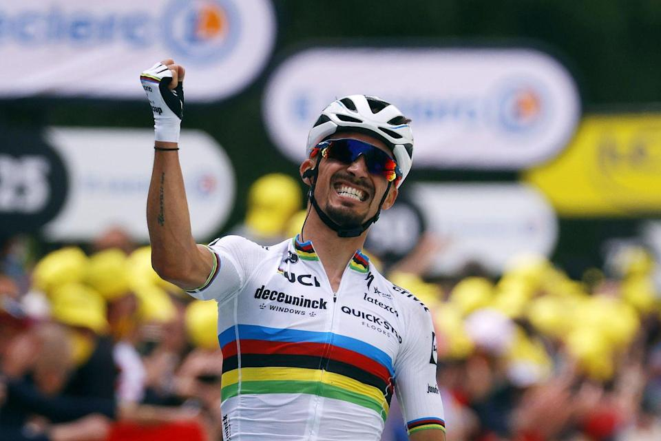 """<p>The 2021 Tour de France got off to a banging start—literally—on Saturday with its opening road stage. The Grand Depart in Brittany, with its small roads and sharp climbs, was always going to be nervous, but Stage 1 was most notable for two huge crashes in the last third of the stage.</p><p>The first, <a href=""""https://twitter.com/Jasperstuyven/status/1408817818854998017"""" rel=""""nofollow noopener"""" target=""""_blank"""" data-ylk=""""slk:caused by a heedless fan who held a cardboard sign in front of the riders"""" class=""""link rapid-noclick-resp"""">caused by a heedless fan who held a cardboard sign in front of the riders</a>, brought down roughly a third of the field. The second, a touch of wheels at high speed with less than 10km to go, took out almost as many and upset many teams' plans for the final climb to the finish at Landerneau. Amazingly, only three riders failed to finish, but any number are banged up.</p><p><strong>Who's winning the Tour?</strong></p><p>World Champion Julian Alaphilippe (Deceuninck-Quick Step) was both smart and lucky enough to avoid both wrecks, and took the stage win and the race's first yellow jersey with a bold attack from more than 2km out on the climb. Other riders, sensing he'd gone too soon, hesitated to follow, but Alaphilippe's jump worked perfectly and he soloed in for the win eight seconds ahead of the chase, led by BikeExchange's Michael Matthews. That's key: with bonus seconds for his victory, Alaphilippe is 12 seconds clear of anyone else in the overall standings. It might not sound like much, but for a rider of Alaphilippe's formidable abilities it's an eternity, and barring crashes—fingers crossed—he should easily defend the lead at least until the first time trial on Stage 5.</p><p><strong>Who's <em>not</em> winning the Tour?</strong></p><p>Israel Start-Up Nation. ISN entered the Tour with high hopes on several levels. Dan Martin was an ideal stage-win hope for Stages 1 and 2, while Michael """"Rusty"""" Woods was in excellent shape and aiming """