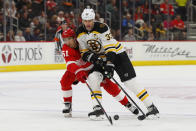 Detroit Red Wings center Valtteri Filppula (51) and Boston Bruins defenseman Zdeno Chara (33) battle for the puck in the first period of an NHL hockey game Sunday, Feb. 9, 2020, in Detroit. (AP Photo/Paul Sancya)
