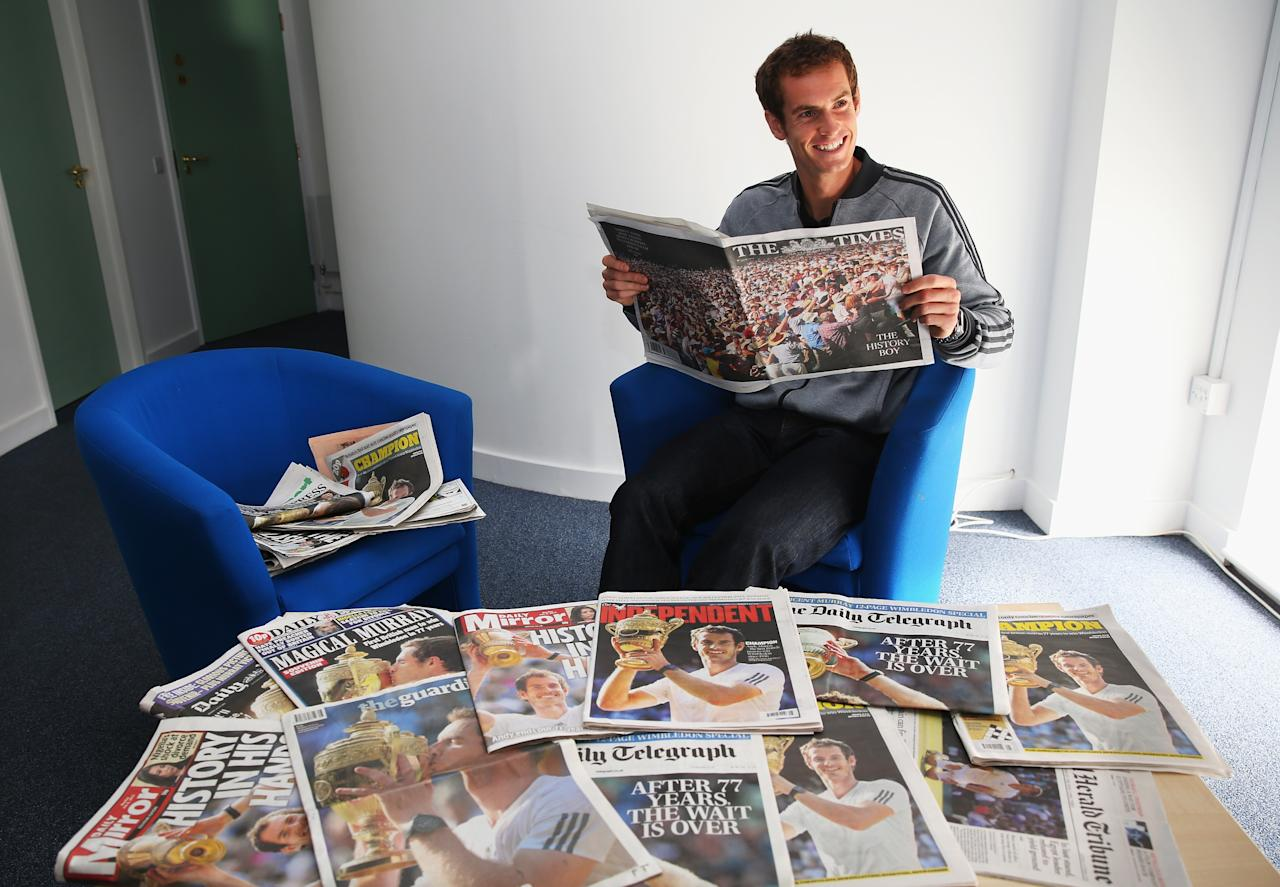 LONDON, ENGLAND - JULY 08: Andy Murray of Great Britain reads through the morning papers at Wimbledon on July 8, 2013 in London, England. (Photo by Julian Finney/Getty Images)