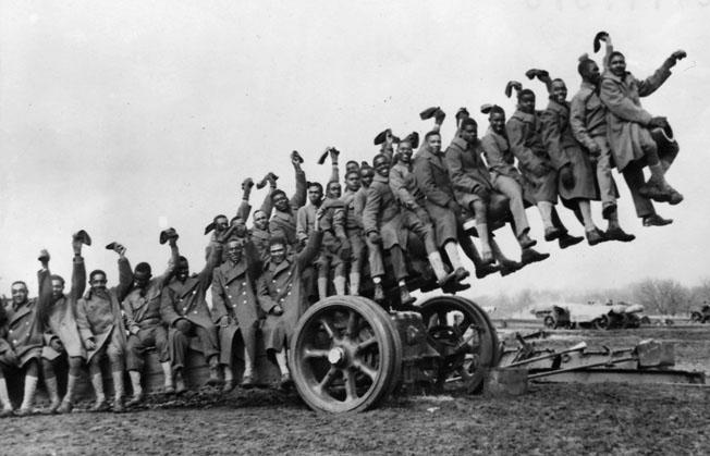 """Members of the 349th Field Artillery Battalion pose for a photo during pre-war training at Fort Sill, Oklahoma. The U.S. Army was dubious about the fighting qualities of """"colored"""" units and many African American soldiers never expected to see combat."""