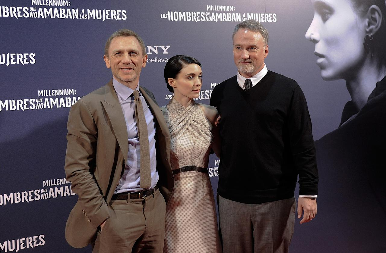 "<a href=""http://movies.yahoo.com/movie/contributor/1800023173"">Daniel Craig</a>, <a href=""http://movies.yahoo.com/movie/contributor/1809789186"">Rooney Mara</a> and <a href=""http://movies.yahoo.com/movie/contributor/1800021714"">David Fincher</a> at the Madrid premiere of <a href=""http://movies.yahoo.com/movie/1810163569/info"">The Girl With the Dragon Tattoo</a> on January 4, 2012"